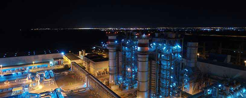 acwapower-plant-lit-up-blue-with-dark-evening-sky-barka